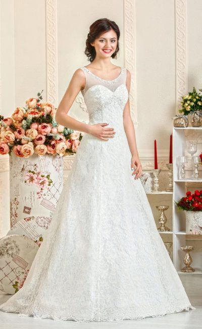 Кружевное свадебное платье А-кроя с элегантным округлым лифом, оформленным тонкой тканью.