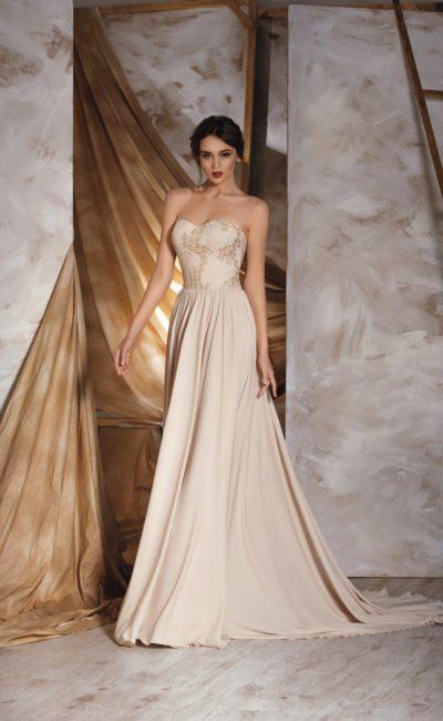 Элегантное свадебное платье кремового цвета с кружевной отделкой открытого корсета.