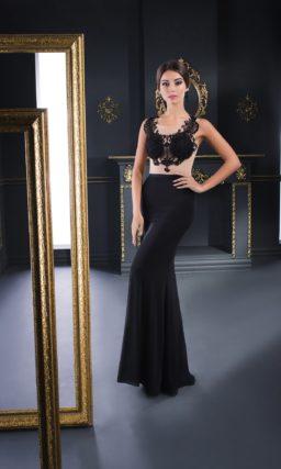 Соблазнительное вечернее платье черного цвета с полупрозрачным верхом.