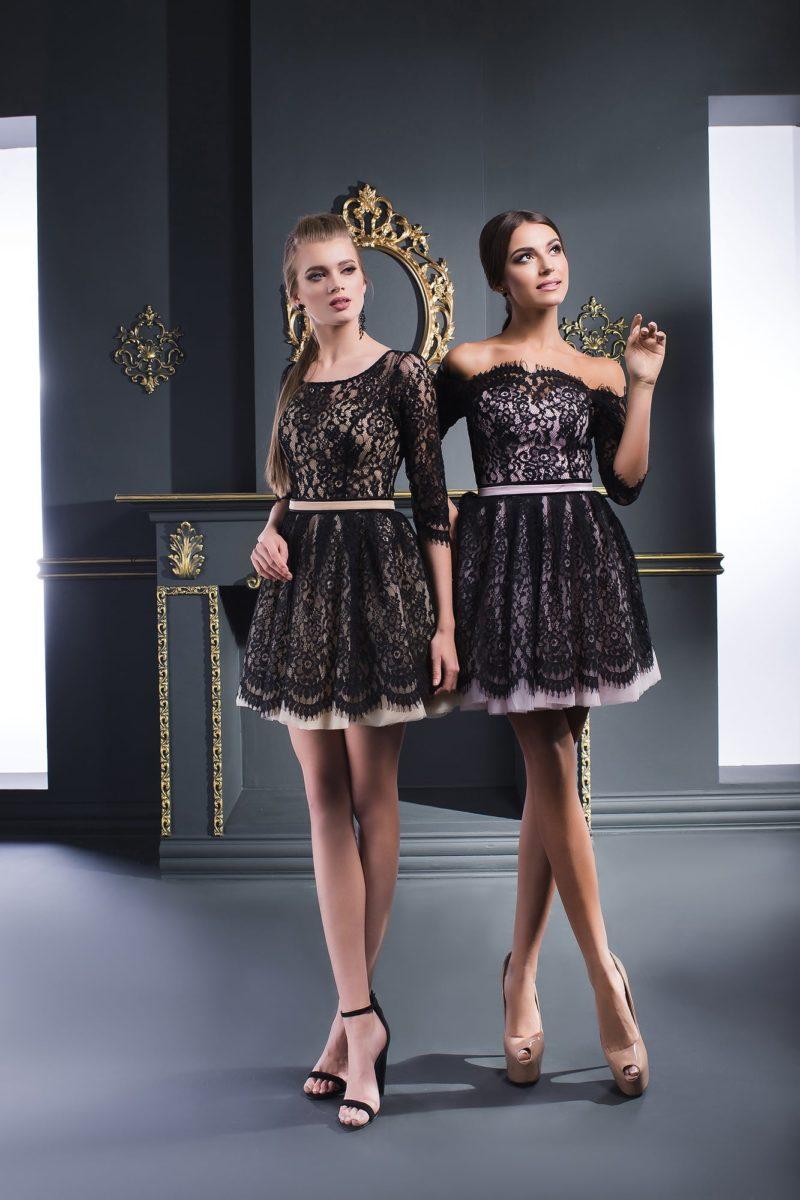 Черное вечернее платье с портретным декольте, оформленное кружевом.