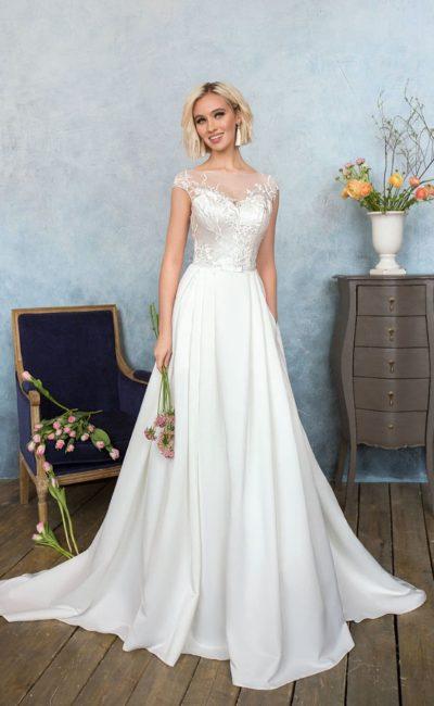 Деликатное свадебное платье «принцесса» с атласным лифом, украшенным вышивкой.