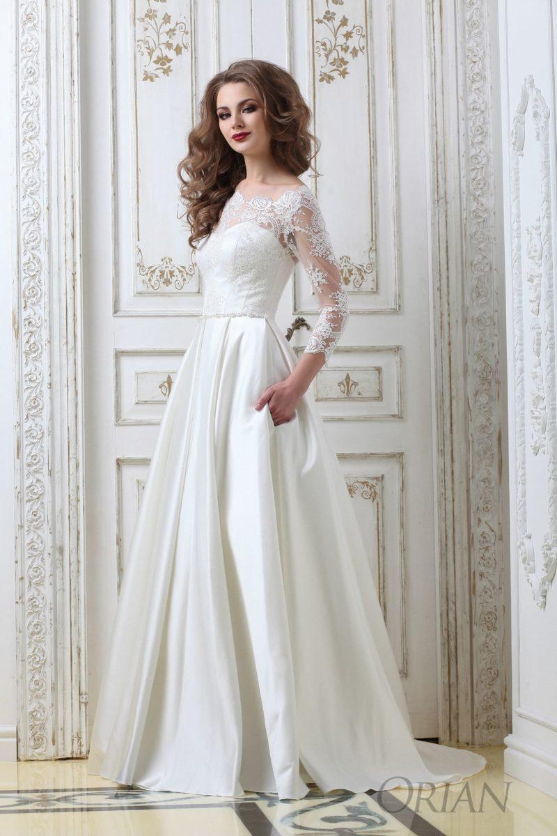 Атласное свадебное платье «принцесса» с рукавом три четверти и скрытыми карманами.