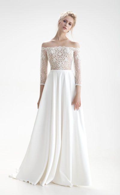 Свадебное платье с юбкой «принцесса» со скрытыми карманами и кружевным верхом.