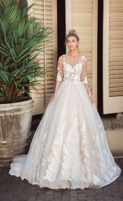 Свадебное платье пышного силуэта с прозрачным рукавом и лифом «сердечком».