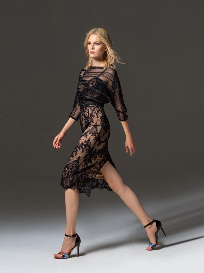 Черное коктейльное платье с широким рукавом и кружевной юбкой.