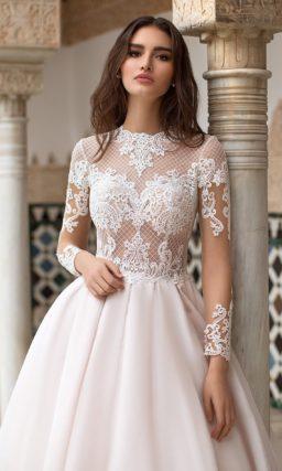Шикарное свадебное платье с полупрозрачным верхом с рукавом.