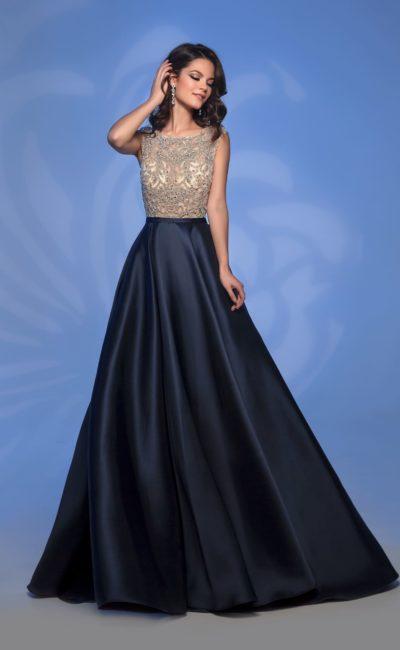 Бежево-черное вечернее платье с длинной атласной юбкой.