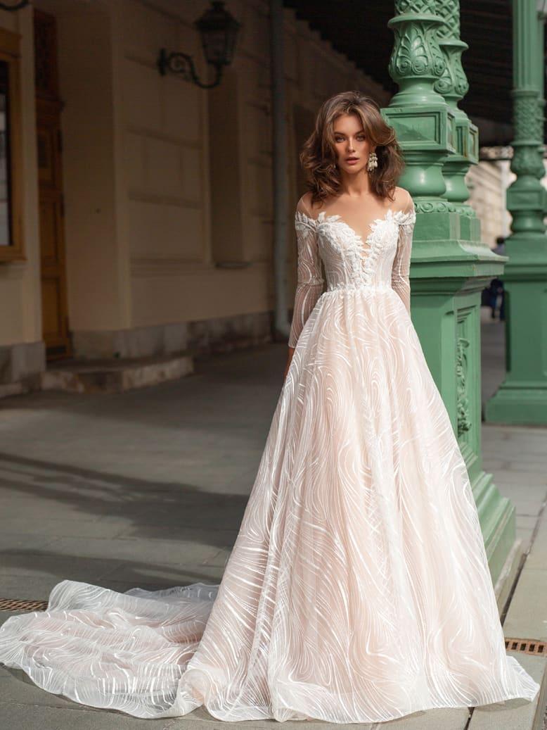 Cвадебное платье оттенка айвори с длинными рукавами